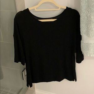 A black flowy tee, size medium